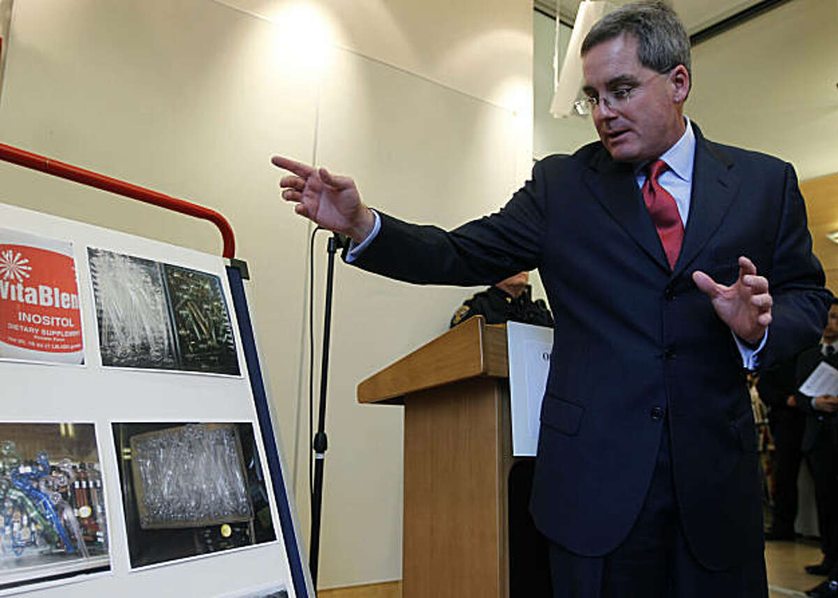 City attorney Dennis Herrera views photos of drug paraphernalia confiscated from smoke shops after he filed lawsuits in San Francisco, Calif., on Thursday, Feb. 17, 2011, against six smoke shops alleging that they continue to sell drug paraphernalia used for smoking crack despite numerous warnings from police officers.