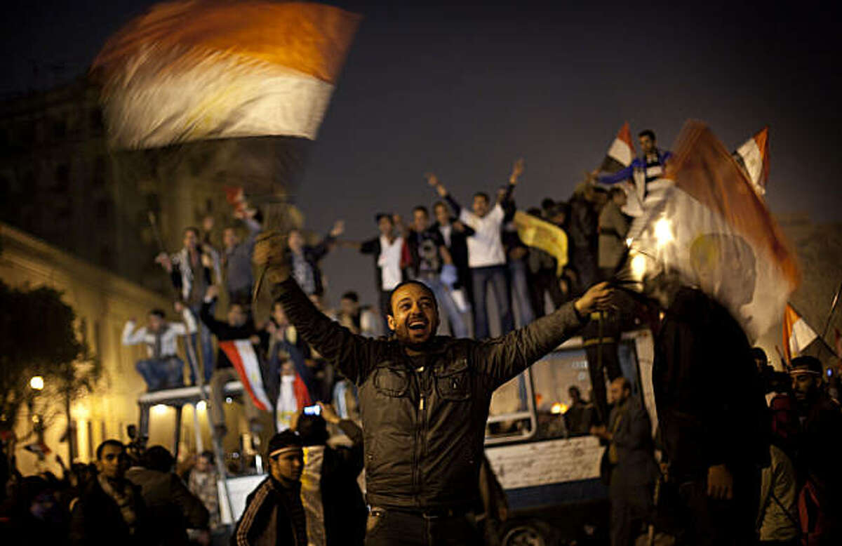 Anti-government protesters celebrate in Tahrir Square in downtown Cairo, Egypt , Egypt Friday, Feb. 11, 2011. Fireworks burst over Tahrir Square and Egypt exploded with joy and tears of relief after pro-democracy protesters brought down President Hosni MAnti-government protesters celebrate in Tahrir Square in downtown Cairo, Egypt , Egypt Friday, Feb. 11, 2011. Fireworks burst over Tahrir Square and Egypt exploded with joy and tears of relief after pro-democracy protesters brought down President Hosni Mubarak with a momentous march on his palaces and state TV. (AP Photo/Emilio Morenatti)
