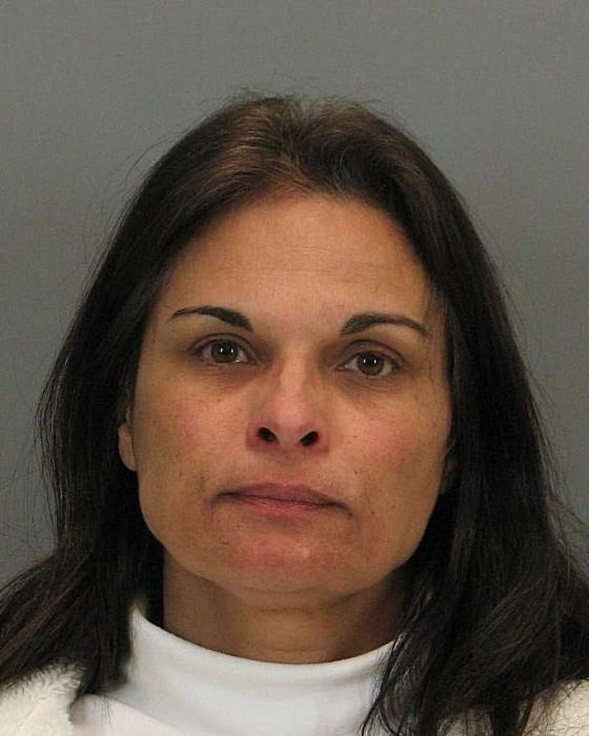 Micheline Johnson, charged with stealing credit card information from American Airlines customers at Mineta San Jose International Airport.