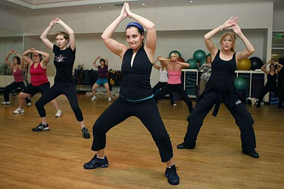 Jody Santiago sweats and dances her way through a Zumba class at Sports Club LA in San Francisco Calif, on Thursday, Feb. 3, 2011. Santiago started taking Zumba classes within the past year. Photo: Washburn, Alex, The Chronicle