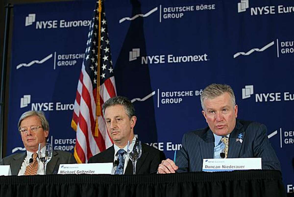 NEW YORK, NY - FEBRUARY 15: New York Stock Exchange (NYSE) Euronext CEO Duncan Niederauer (R), Michael S. Geltzeiler (C), Chief Financial Officer and Jan-Michiel Hessels, Chairman of NYSE Euronext, speak to the media following the announcement that the NYSE Euronext, the parent company of the New York Stock Exchange, will merge with the Germany's Deutsche Boerse to form the world's largest exchange for stocks and derivatives on February 15, 2011 in New York City. The new company, which has yet to be named, will be 60% owned by Deutsche Boerse shareholders, while existing NYSE Euronext shareholders will own the remaining 40%. Pending approval the $10 billion merger is expected to be completed by the end of 2011.