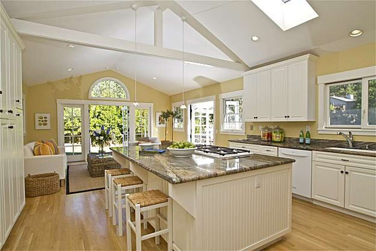 The modern kitchen adjoins the family area. The Larkspur property was originally built in 1939.