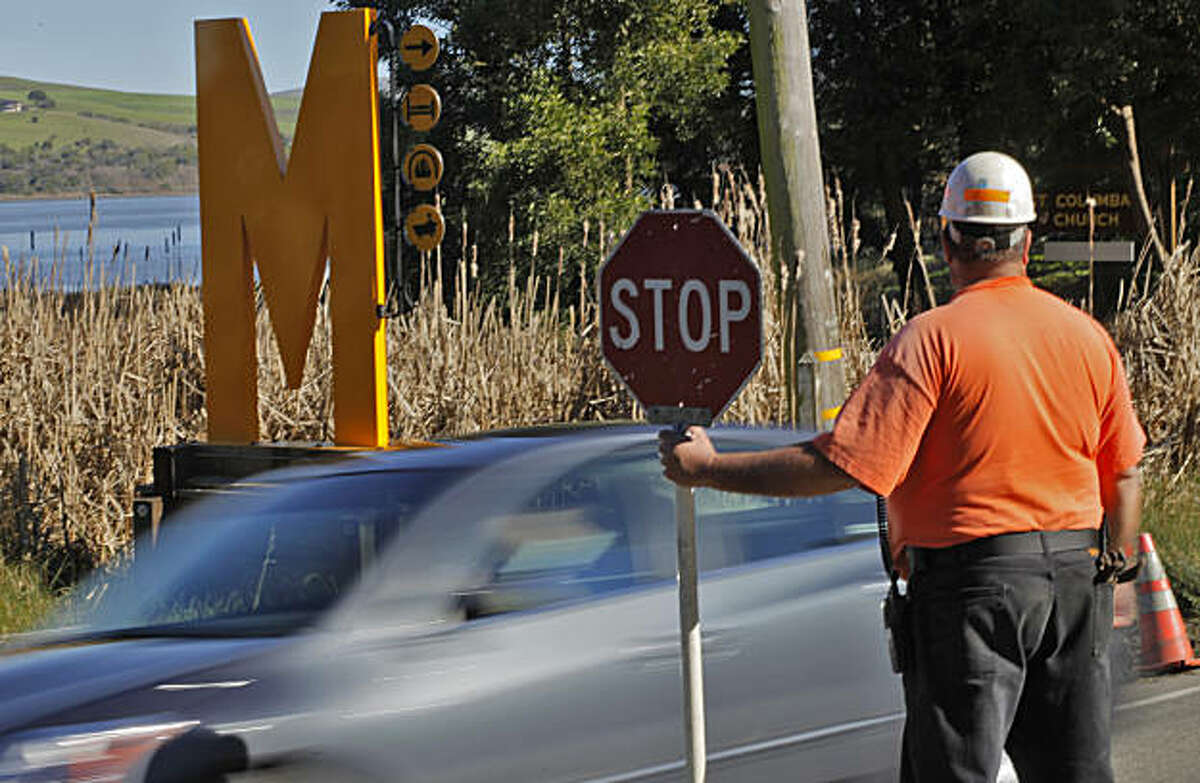 Drivers are told to stop or slow down by the County of Marin for roadwork along Sir Francis Drake, Thursday February 10, 2011, in Inverness, Calif. The public can see the signs such as the new Mankas sign along the road. Even with a large amount of the communities support due to West Marin political conflict the famous lodge is being made to take their sign down by Monday.
