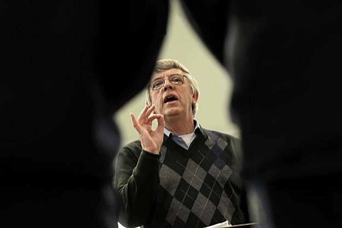 Ian Robertson conducts the San Francisco Boys Choir during rehearsal, Wednesday January 19, 2011, in San Francisco, Calif.