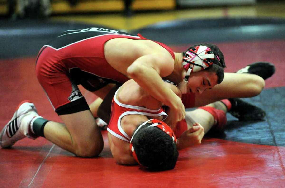 Fairfield Warde's Phil Neamonitis wrestles Greenwich's Cameron Gray, during boys wrestling action in Fairfield, Conn. on Wednesday January 11, 2012.