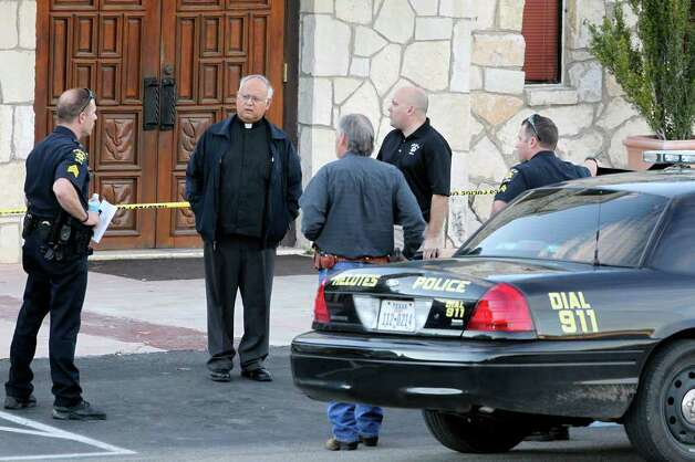METRO  Officers check with the priest (Carlos Davalos?) at the scene of a shooting at Our Lady of Guadalupe Catholic Church in Helotes on January 11, 2012 Tom Reel/Staff Photo: TOM REEL, SAN ANTONIO EXPRESS-NEWS / © 2012 San Antonio Express-News  MAGS OUT; TV OUT; NO SALES; SAN ANTONIO OUT; AP MEMBERS ONLY; MANDATORY CREDIT; EFE OUT