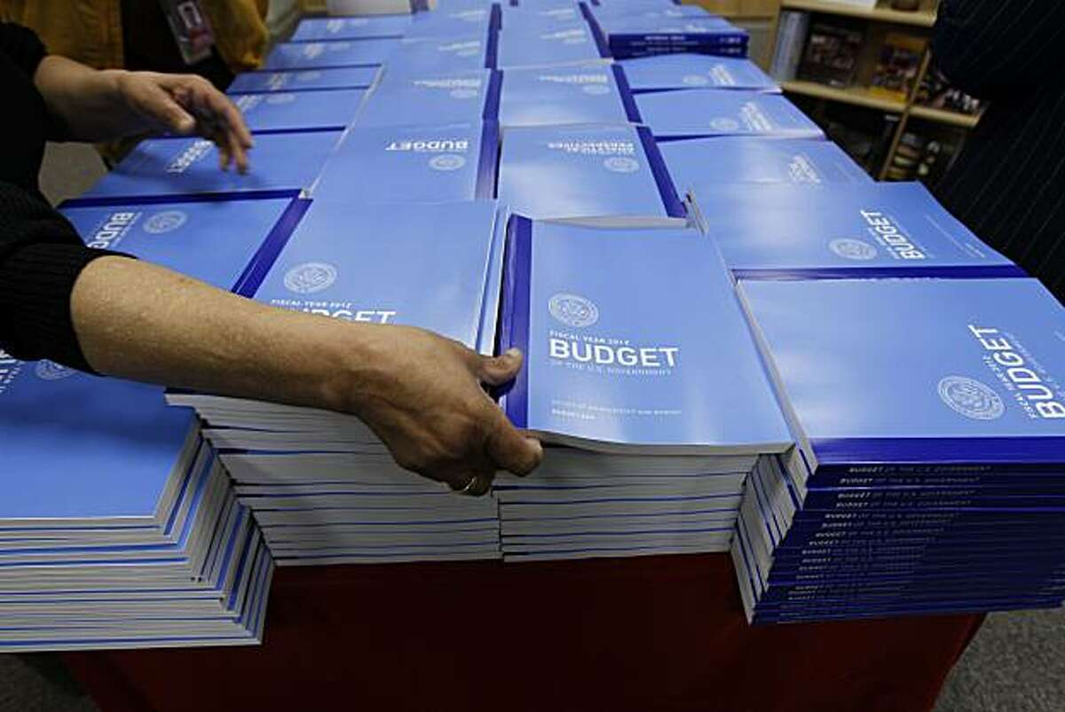 Copies of the U.S. Government budget for Fiscal Year 2012 are stacked up at the U.S. Government Printing Office in Washington, Monday, Feb. 14, 2011.