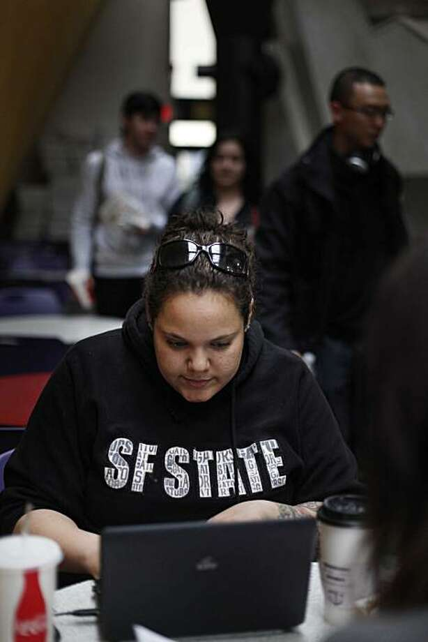 "San Francisco State student Ellie Lieberman, 23, of Los Angeles, works on class in the student Center on Monday Feb. 14, 2011 in San Francisco, Calif. Lieberman said she isn't sure she's getting the education she's paid for and said, ""Student from California should get 100% preferential treatment.""  The CSU system for the first time is turning down eligible students at the budget tightens. The state's legislative analyst is responding by recommending that state school only pull from local applicants instead of reaching up and down the state for students. Photo: Mike Kepka, The Chronicle"