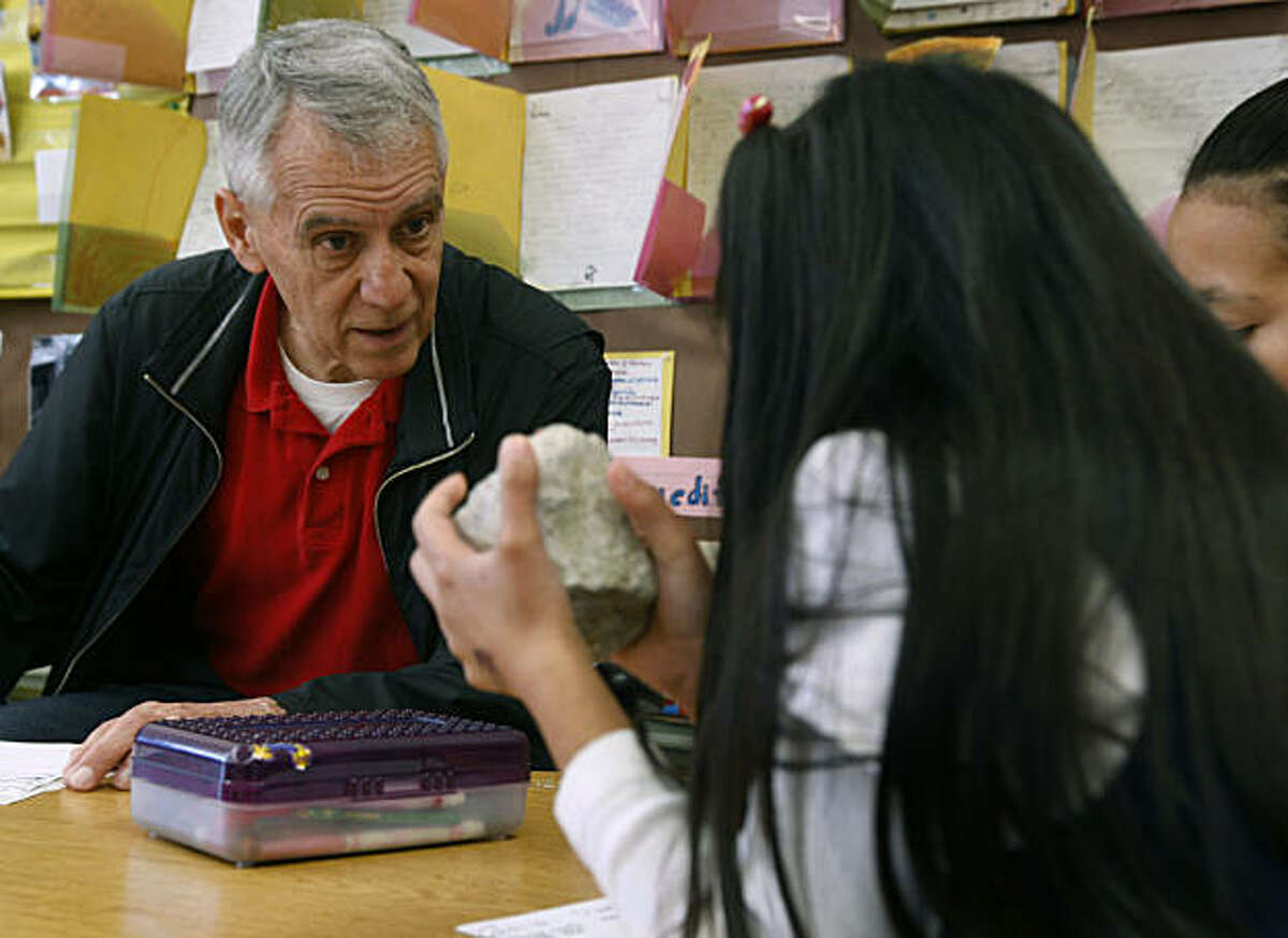 John Weidinger tutors second graders at Cleveland Elementary School in San Francisco, Calif., on Tuesday, Feb. 1, 2011. The retired police officer is being honored by S.F. General Hospital for his longtime volunteerism at his former elementary school.