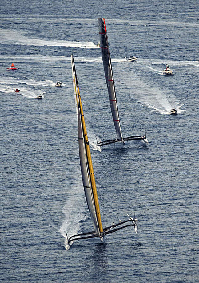 American BMW Oracle BOR 90, left, and Swiss Alinghi 5, right, sail during race 2 of the 33rd America's Cup off Valencia, Spain, on Sunday, Feb. 14, 2010. Photo: Daniel Ochoa De Olza, AP