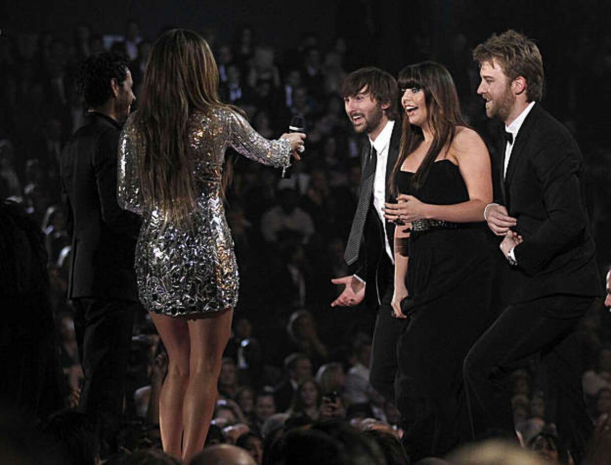 From left, Marc Anthony and Jennifer Lopez present Lady Antebellum with the award for best record of the year at the 53rd annual Grammy Awards on Sunday, Feb. 13, 2011, in Los Angeles. From right are, Charles Kelley, Hillary Scott and Dave Haywood.