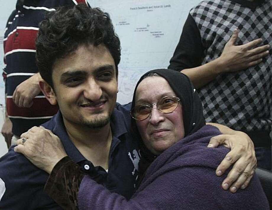Egyptian Wael Ghonim, a Google Inc. marketing manager, who has become a hero of the demonstrators since he went missing on Jan. 27, two days after the protests began, hugs the mother of Khaled Said, a young 28-year-old businessman who died in June, 2010,at the hands of undercover police, setting off months of protests against the hated police, at Tahrir Square in Cairo, Egypt, Tuesday, Feb.8, 2011. Photo: Ahmed Ali, AP