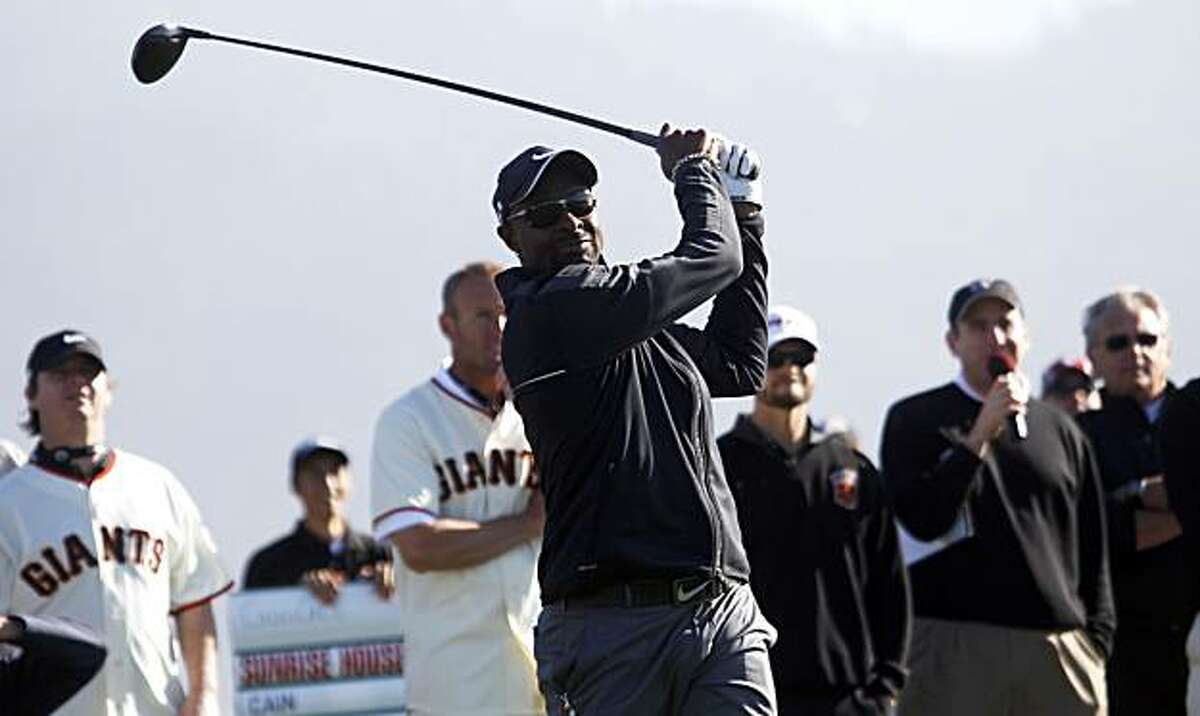 49ers great Jerry Rice tees off on the 18th hole at the 49ers-Giants charity shootout at the AT&T Pro-Am in Pebble Beach on Tuesday.