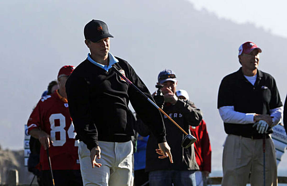 San Francisco Giants pitcher Matt Cain flips his club after teeing off on the 18th hole in the 49ers-Giants charity shootout at the AT&T Pro-Am in Pebble Beach on Tuesday.