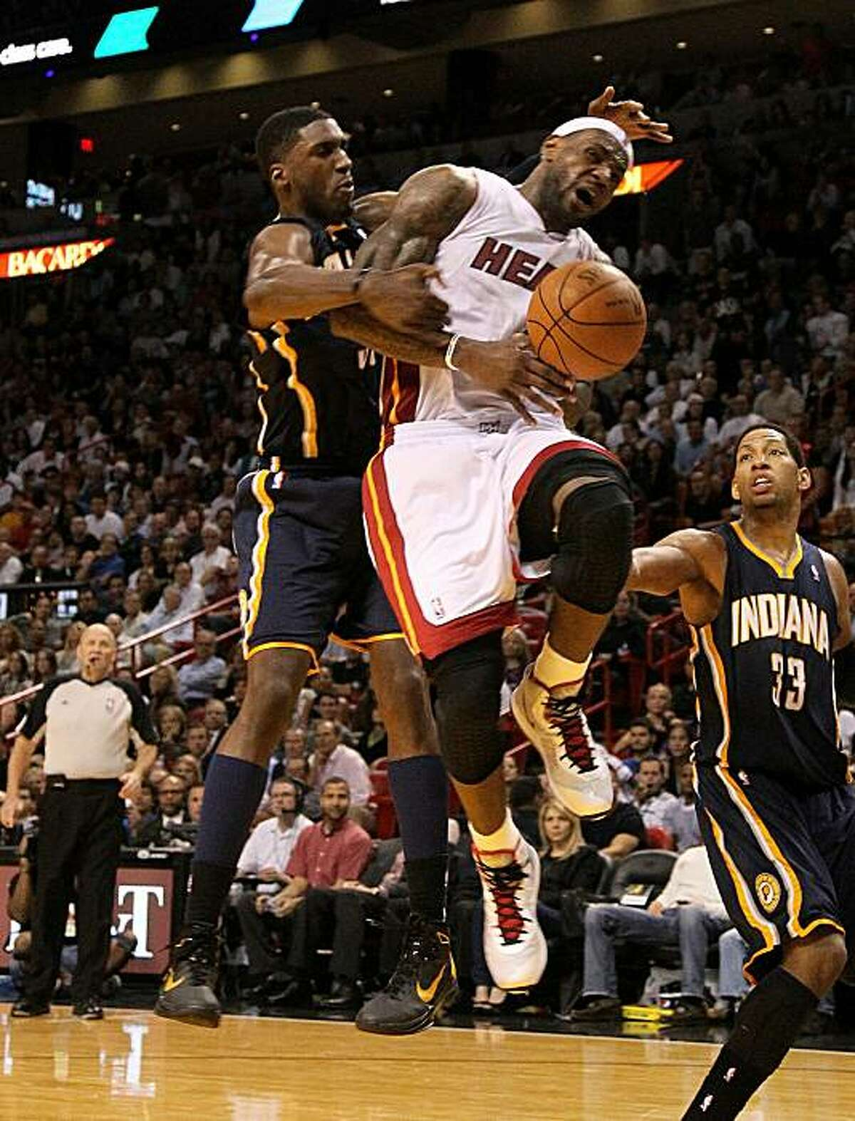 MIAMI, FL - FEBRUARY 08: LeBron James #6 of the Miami Heat is fouled by Roy Hibbert #55 of the Indiana Pacers during a game at American Airlines Arena on February 8, 2011 in Miami, Florida. NOTE TO USER: User expressly acknowledges and agrees that, by downloading and/or using this Photograph, User is consenting to the terms and conditions of the Getty Images License Agreement.