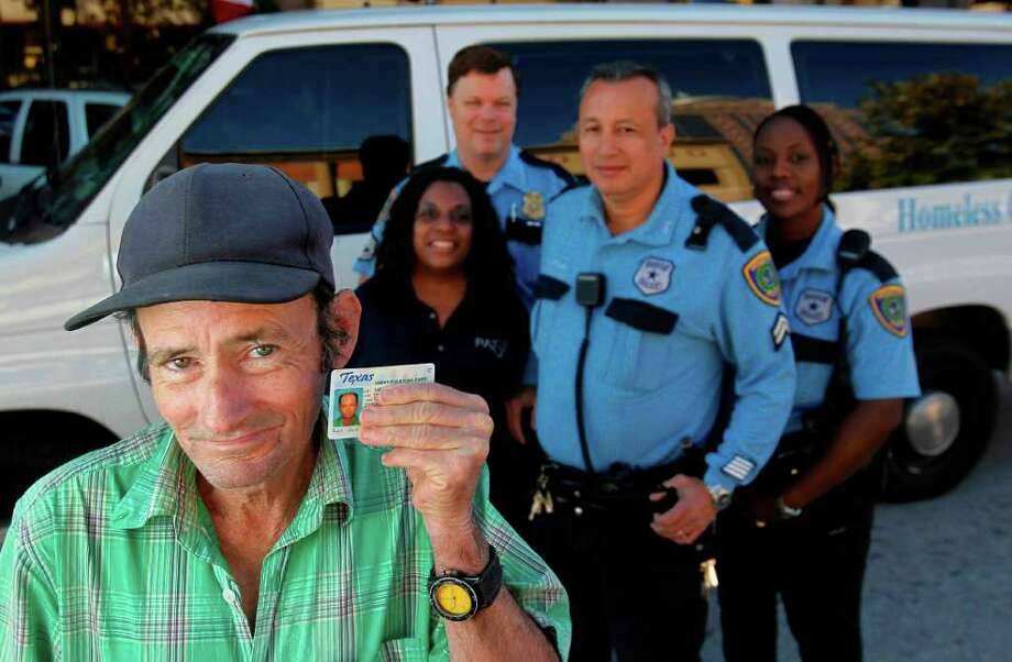 Richard Stickle holds his Texas ID obtained with the help of the Houston Police Department's  Homeless Outreach Team and caseworker Deirdre Charles. Photo: Mayra Beltran / © 2011 Houston Chronicle