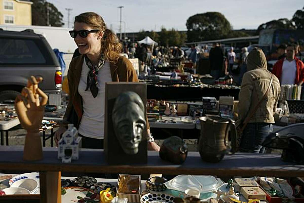 Kristina Tosi scouts for antique items at the Alemany Flea Market to sell from her online vintage, farmhouse chic shop Cottage Farm in San Francisco, Calif. on Sunday, Nov. 14, 2010.
