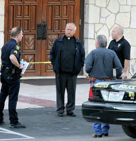 Helotes police officers talk with Monsignor Carlos Davalos, the pastor at Our Lady of Guadalupe Catholic Church, where a double shooting occured Wednesday, Jan. 11, 2012. Photo: TOM REEL, SAN ANTONIO EXPRESS-NEWS / © 2012 San Antonio Express-News  MAGS OUT; TV OUT; NO SALES; SAN ANTONIO OUT; AP MEMBERS ONLY; MANDATORY CREDIT; EFE OUT