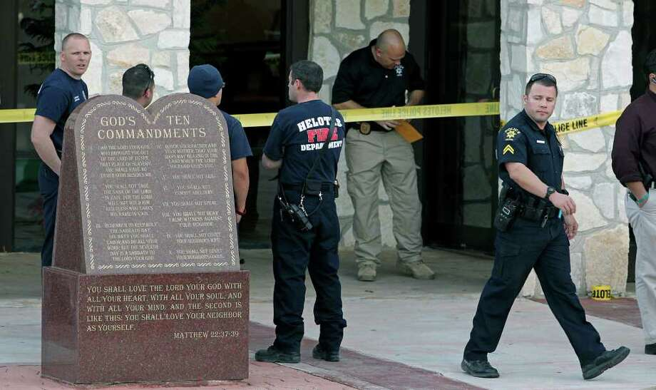 Law enforcement officials gather at the scene of a double shooting at Our Lady of Guadalupe Catholic Church in Helotes. Photo: TOM REEL, SAN ANTONIO EXPRESS-NEWS / © 2012 San Antonio Express-News  MAGS OUT; TV OUT; NO SALES; SAN ANTONIO OUT; AP MEMBERS ONLY; MANDATORY CREDIT; EFE OUT