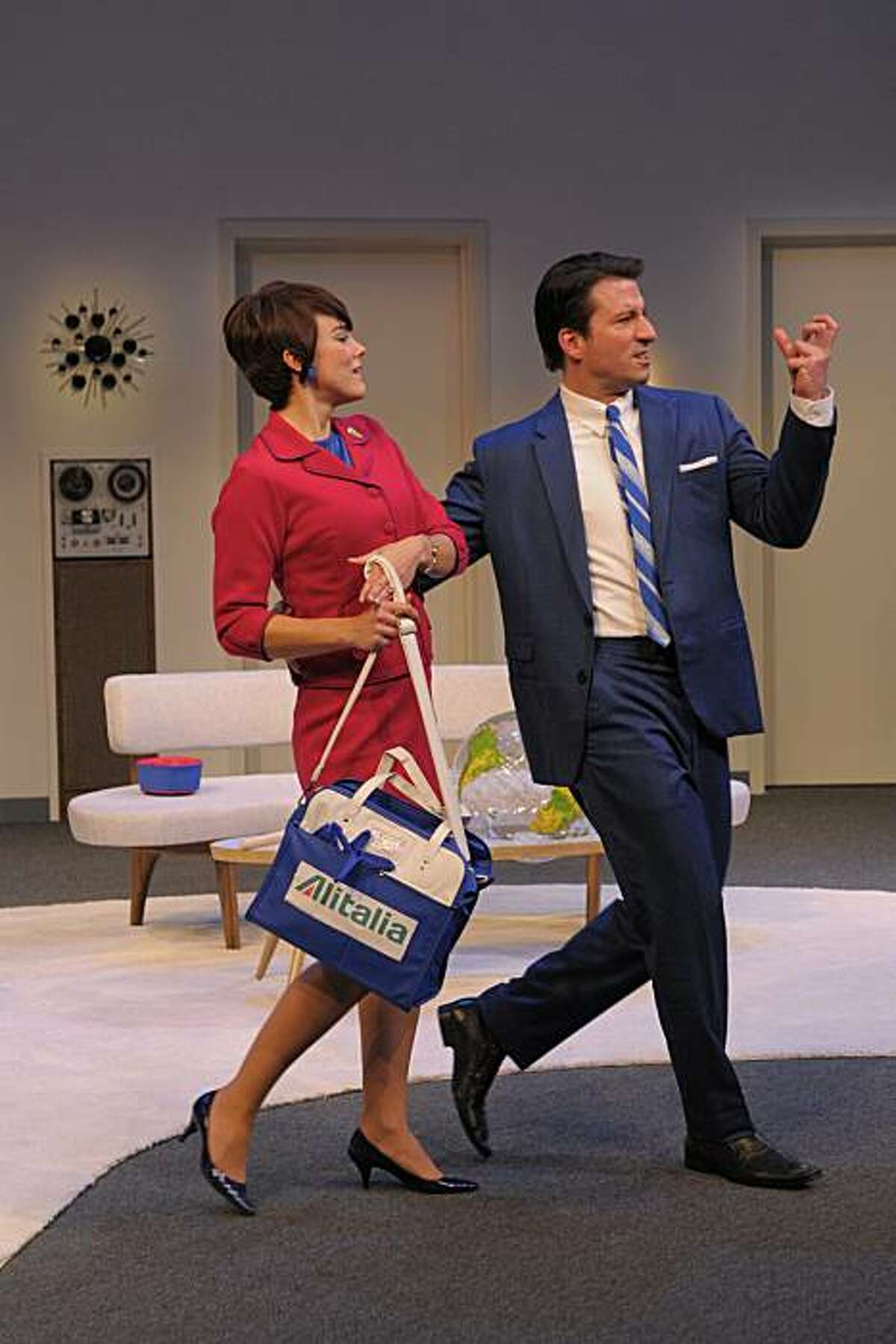 Bernard (Liam Vincent, right) with his flight attendant fiancee Gabriella (Jessica Lynn Carroll) in Center Rep's production of
