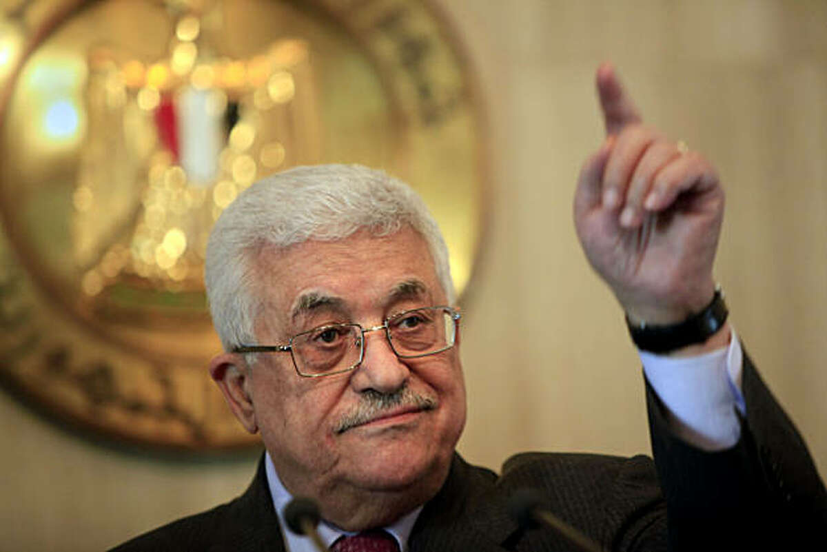Palestinian authority President Mahmoud Abbas talks during a press conference following his meeting with Egyptian President Hosni Mubarak, not pictured, at the Presidential palace in Cairo, Egypt, Monday, Jan. 24, 2011. Egyptian Presidency logo is seen atbackground.
