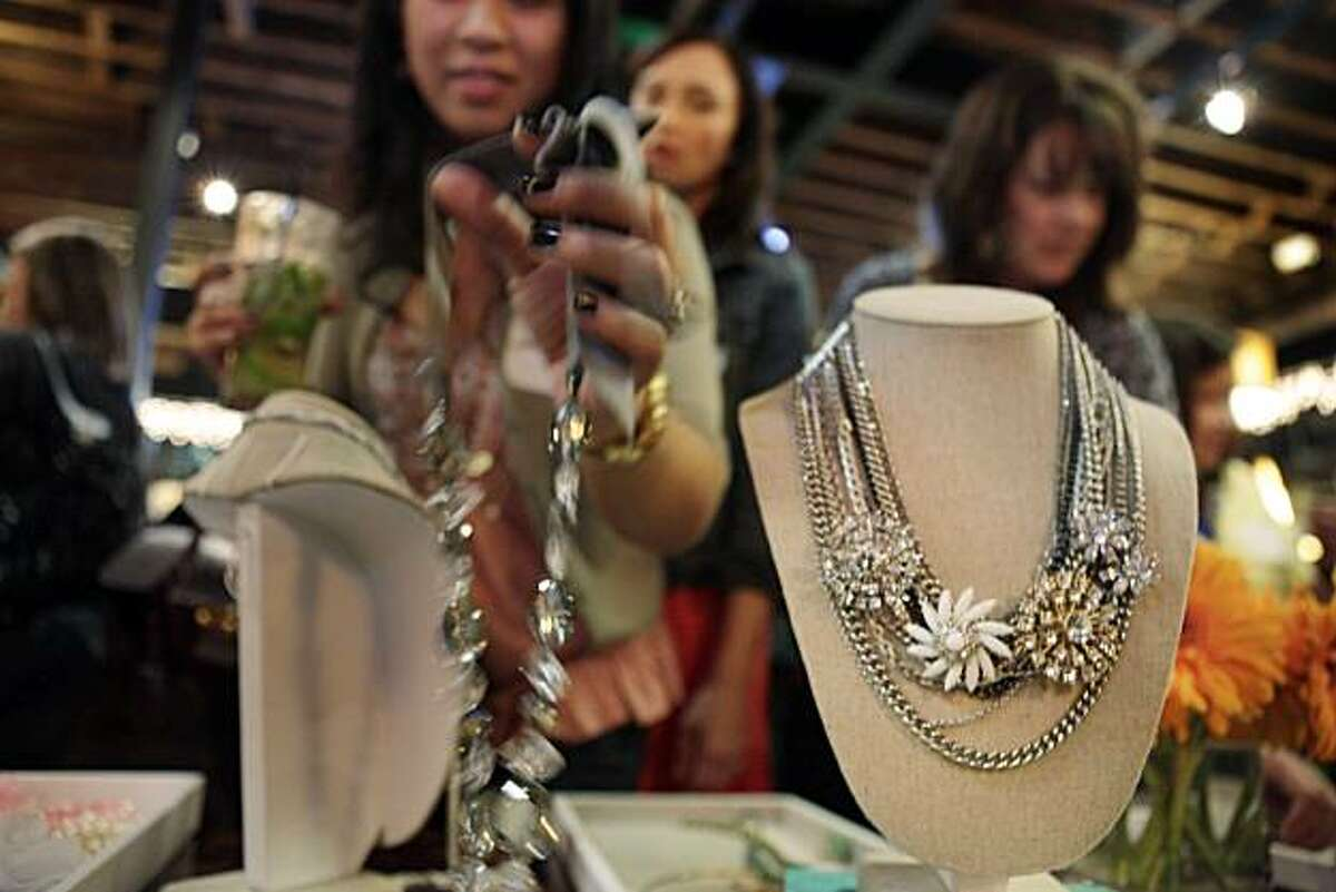 Party guests peruse new designs for Stella & Dot at a release party at Billy Berk's in San Jose, Calif., on Sunday, January 23, 2011. Stanford graduate Jessica Herrin co-founded WeddingChannel.com at age 24. Now she's started Stella & Dot, in which its army of independent sellers throw parties and sell jewelry in the style of Pampered Chef and Avon. It sees itself changing past notions of direct sales, tapping the web and social media to help its stylists, many of them moms like herself.