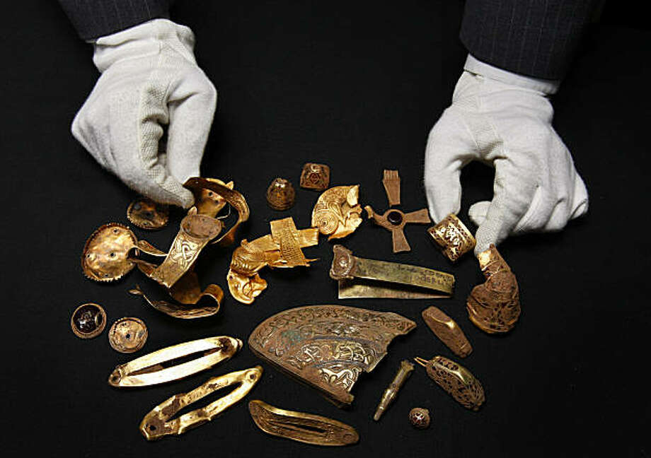 Part of a recently discovered hoard of Anglo-Saxon gold is displayed at Birmingham Museum in Birmingham, England Thursday, Sept. 24, 2009.  Amateur treasure hunter Terry Herbert was prowling English farmland in Staffordshire, England, with a metal detector when he stumbled upon what has been described as the largest Anglo-Saxon treasure ever discovered, a massive collection of gold and silver crosses, sword decorations and other items, British archaeologists said Thursday.  One expert said the treasure would revolutionize understanding of the Anglo-Saxons, a Germanic people who ruled England from the fifth century until the Norman conquest in 1066. Photo: Kirsty Wigglesworth, AP