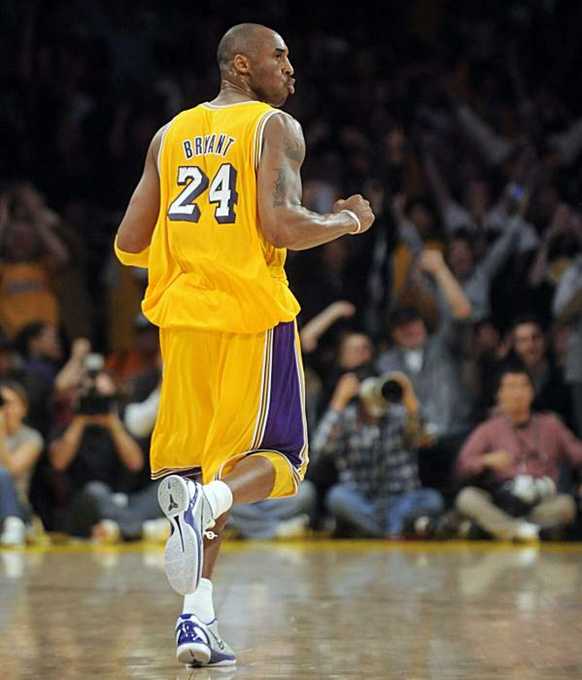 Los Angeles Lakers guard Kobe Bryant celebrates during the first half of an NBA basketball game against the Boston Celtics in Los Angeles, Sunday, Jan. 30, 2011.