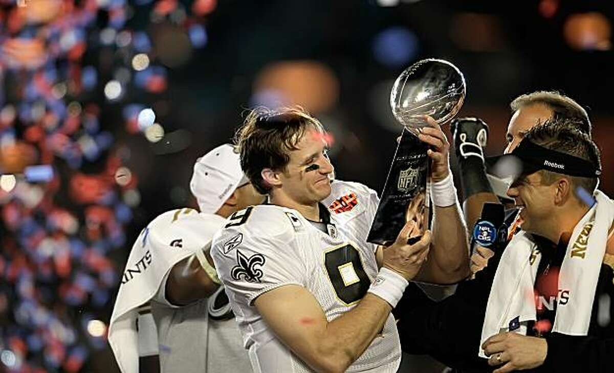 Saints quarterback Drew Brees and Sean Payton admire the trophy as the New Orleans Saints beat the Indianapolis Colts 31-17, Sunday, February 7, 2010 in Super Bowl XLIV at Sun Life Stadium in Miami Gardens, Florida. (Joe Rimkus Jr/Miami Herald/MCT)