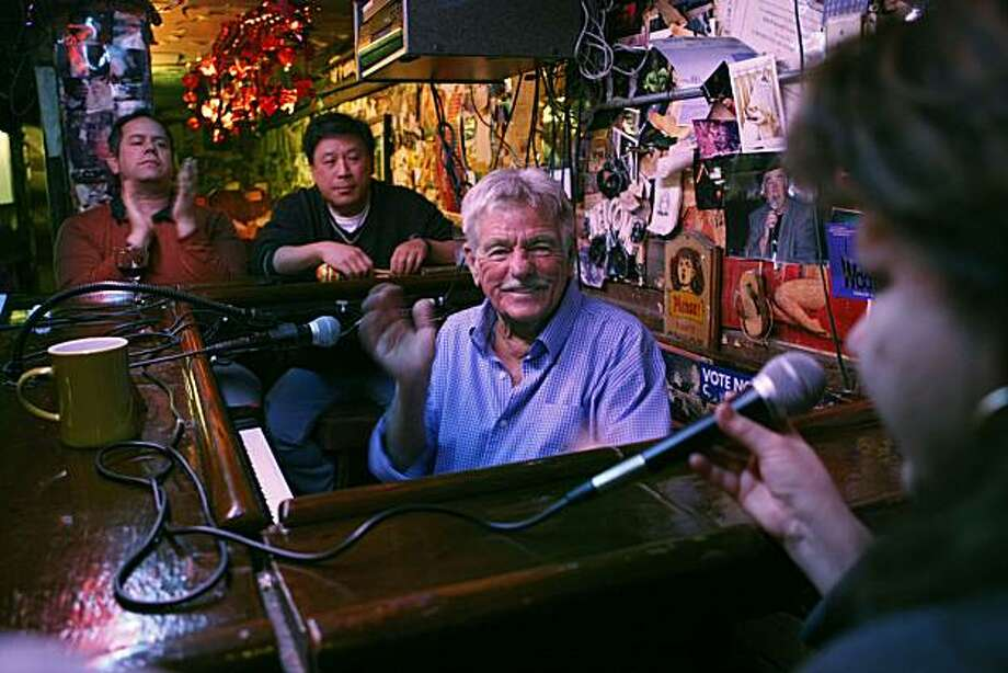 Rod Dibble claps in approval after a woman finishes singing to his music at The Alley bar in Oakland Calif, on Friday, Feb. 4, 2011. Dibble jokes with fans throughout the night and rings a cowbell when he he thinks someone has sung particularly well. Photo: Washburn, Alex, The Chronicle