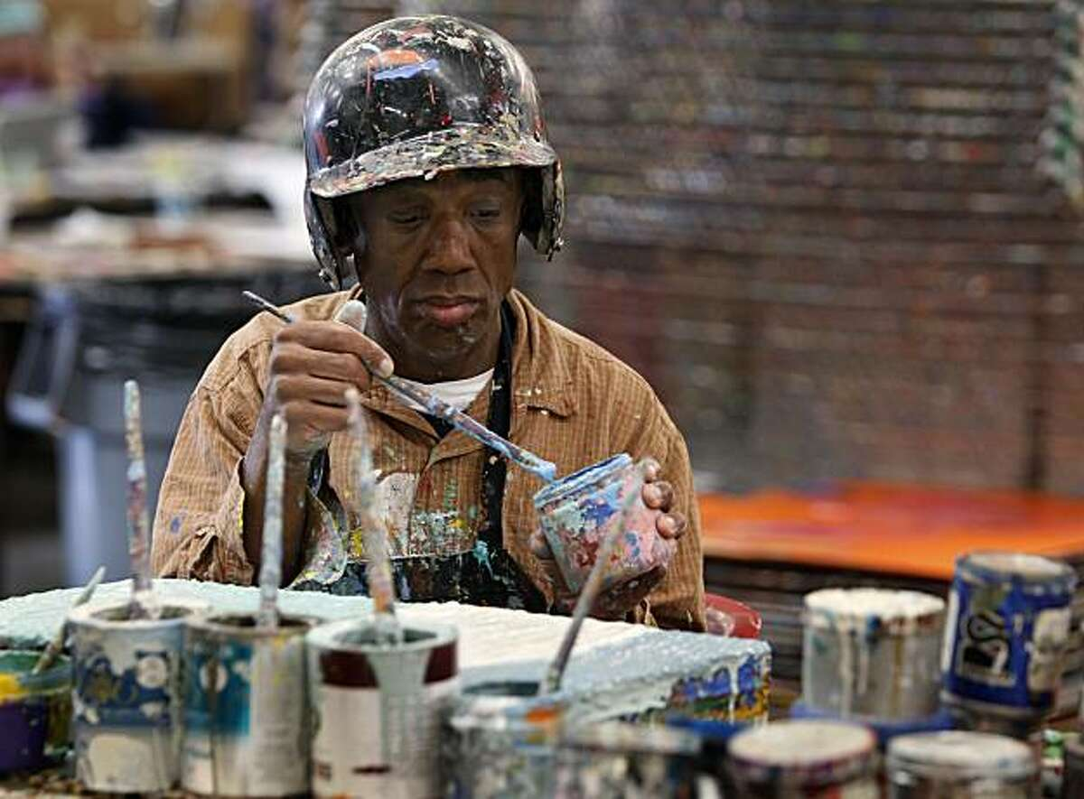 Artist Willie Harris works on his latest painting at the National Institute for Art and Disabilities in Richmond, Calif., on Friday, Jan. 14, 2011. Harris has paintings in the