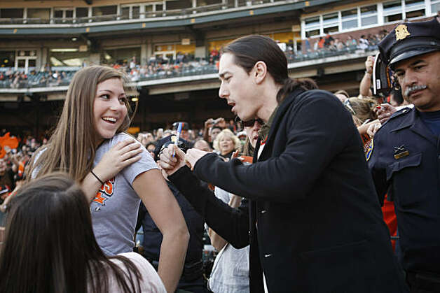 Talia Fusara smiles as Tim Lincecum signs the shoulder of her shirt during FanFest at AT&T Park in San Francisco Calif. on Saturday, Feb. 5, 2011. Photo: Alex Washburn, The Chronicle