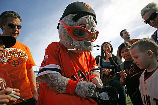 Lou Seal, the Giants' mascot, signs a hat for Zachariah Ott, 6 years old, right. Fans celebrate the San Francisco Giants at FanFest, held at AT&T Park on Saturday February 5, 2011. Photo: Anna Vignet, The Chronicle