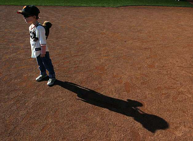 Joey Scovill, 4, played on the infield at AT&T Park Saturday. Photo: Lance Iversen, The Chronicle