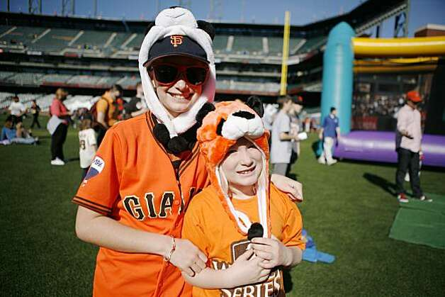 Olivia Towery, 11 (left) and sister Paige Towery, 7, show their Giants pride at Fan Fest. Photo: Anna Vignet, The Chronicle