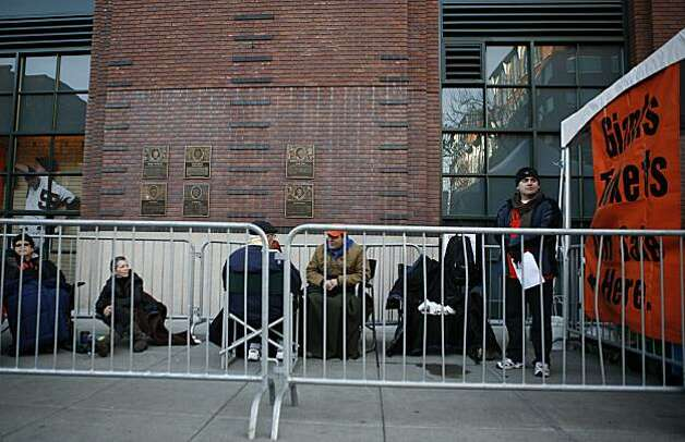 Daniel Lucero, far right, of San Jose, is the first in line to buy tickets to opening games of the Giants' 2011 season. Photo: Anna Vignet, The Chronicle