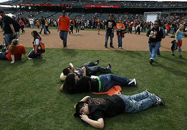 Hundreds of fans walk around the Giants infield trying to catch a glimpse of their favorite players at the annual FanFest at AT&T Park on Saturday. Photo: Lance Iversen, The Chronicle