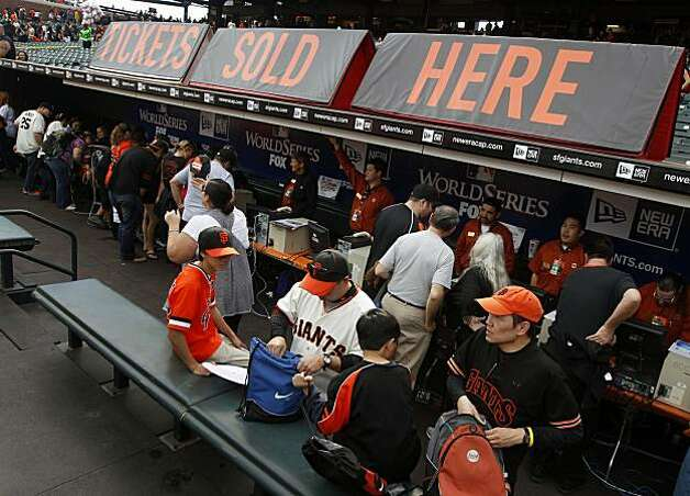 Hundreds of Giants fans take advantage of advance ticket sales in AT&T Park's visitors' dugout at FanFest on Saturday. Photo: Lance Iversen, The Chronicle