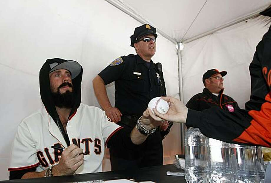 Giants relief pitcher Brian Wilson was one of several dozen players that took part in signing autographs Saturday at AT&T Park. Photo: Lance Iversen, The Chronicle