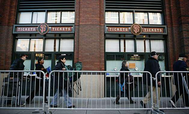 People waiting in line to buy opening game tickets to the San Francisco Giants are led to the ticket windows. Photo: Anna Vignet, The Chronicle