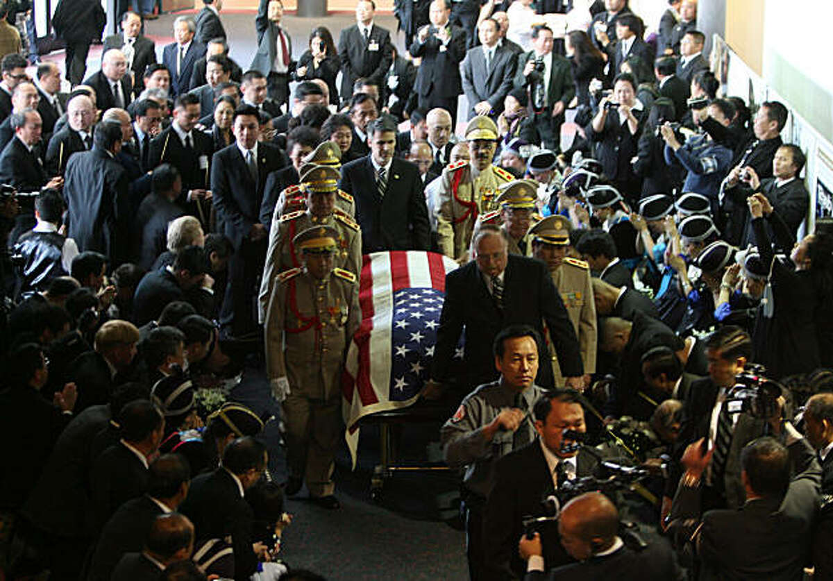 The casket of General Vang Pao is brought into the Fresno Convention Center, Friday, Feb. 4, 2011 in Fresno, Calif. A horse-drawn carriage holding the body of the late Gen. Vang Pao passed thousands of sobbing mourners in military uniform and traditional Hmong dress Friday, as crowds gathered in downtown Fresno to begin an elaborate, six-day funeral service. Vang Pao's large extended family, including his 25 surviving children , as well as the former CIA officials who recruited him to lead a secret army during the Vietnam War followed his flag-draped casket. The general died at age 81 on Jan. 6 near Fresno, and is revered as a leader and father figure by the Hmong and Lao people he helped to resettle across the globe once Saigon fell.