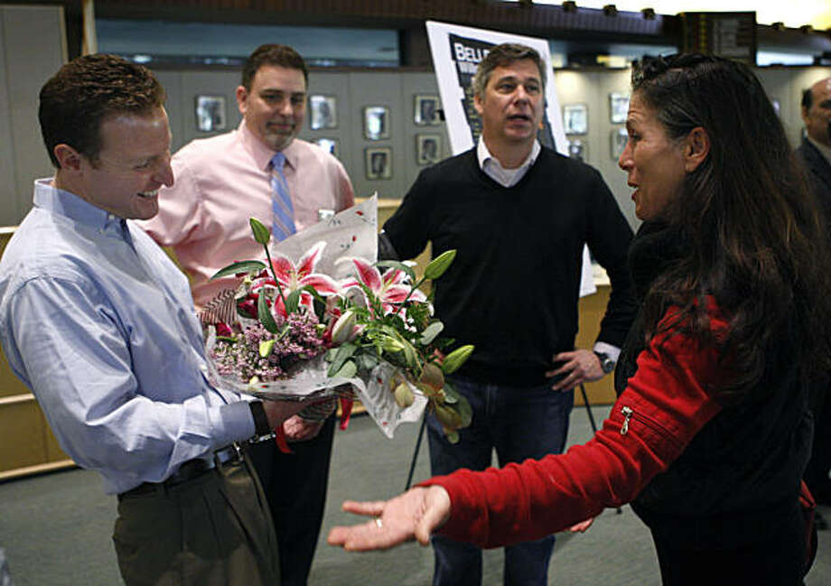 "Katherine Giusto welcomes Facebook chief financial officer David Ebersman (left) to the neighborhood after the social network announced that it will relocate its headquarters to the old Sun Microsystems campus in Menlo Park, Calif., on Tuesday, Feb. 8, 2011. Giusto owns a flower shop near the site. ""We're excited, the whole neighborhood has been suffering,"" Giusto said. Standing in the background is Menlo Park mayor Rich Cline and Facebook director of real estate John Tenanes. Photo: Paul Chinn, The Chronicle"