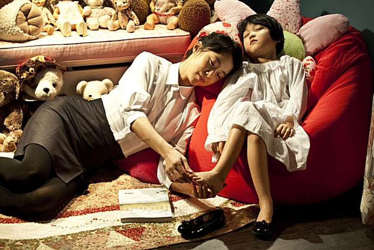 Jeon Do-Youn as EUN-YI and Ahn Seo-hyeon as NAMI in THE HOUSEMAID directed by IM Sang-soo