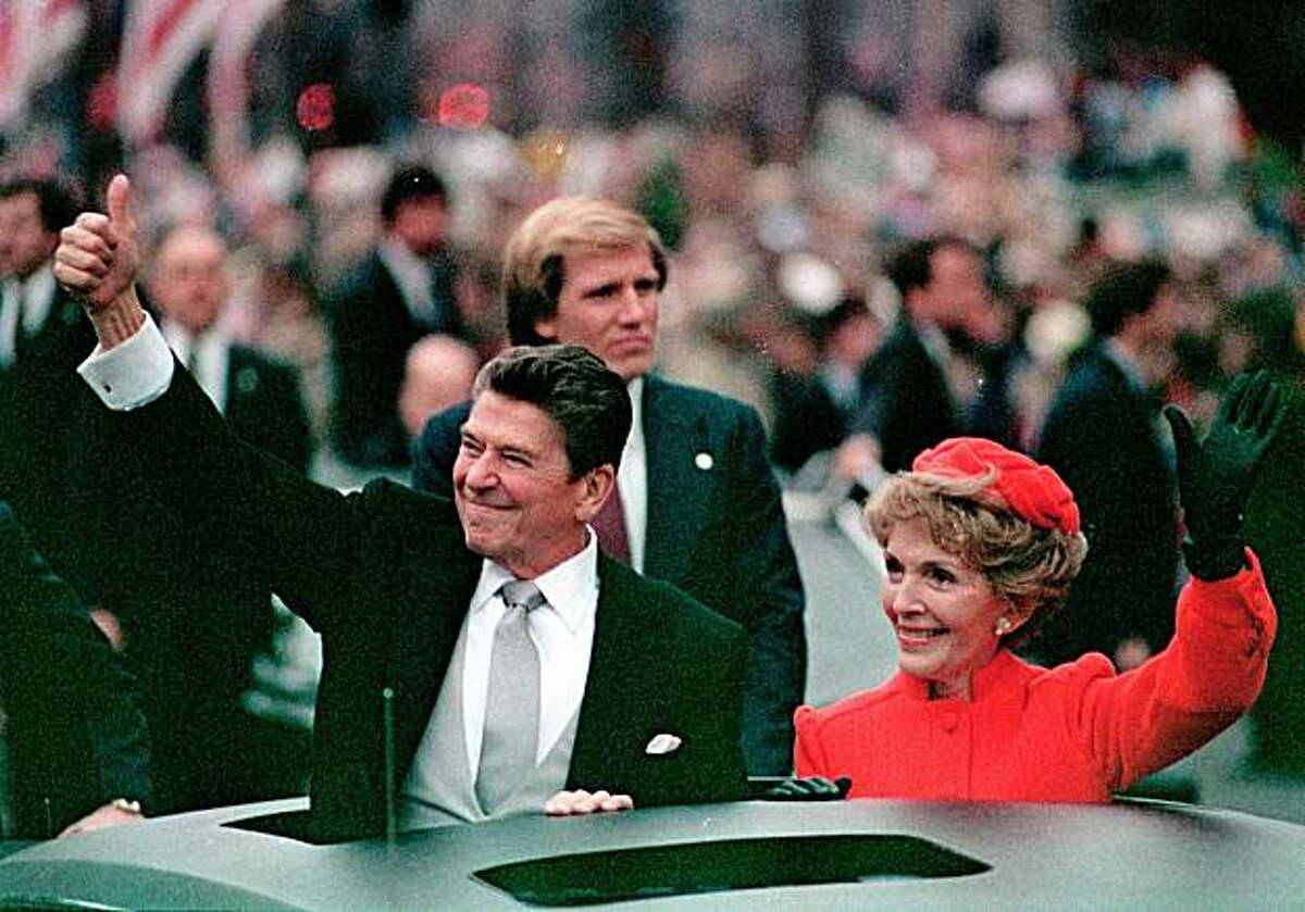 FILE- This Jan. 20, 1981 file photo, shows President Ronald Reagan as he gives a thumbs up to the crowd while his wife, first lady Nancy Reagan, waves from a limousine during the inaugural parade in Washington following Reagan's swearing in as the 40th president of the United States. Sunday, Feb. 6, 2011, marks the centennial anniversary of Reagan's birth.