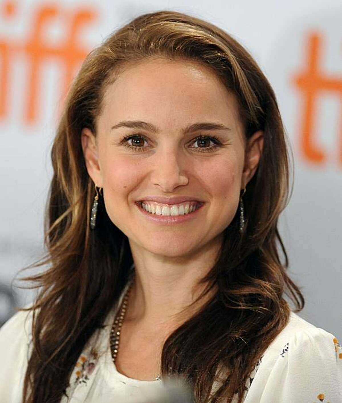 """Actress Natalie Portman participates in a news conference for the film """"Love And Other Impossible Pursuits"""" during the Toronto International Film Festival on Wednesday, Sept. 16, 2009 in Toronto."""