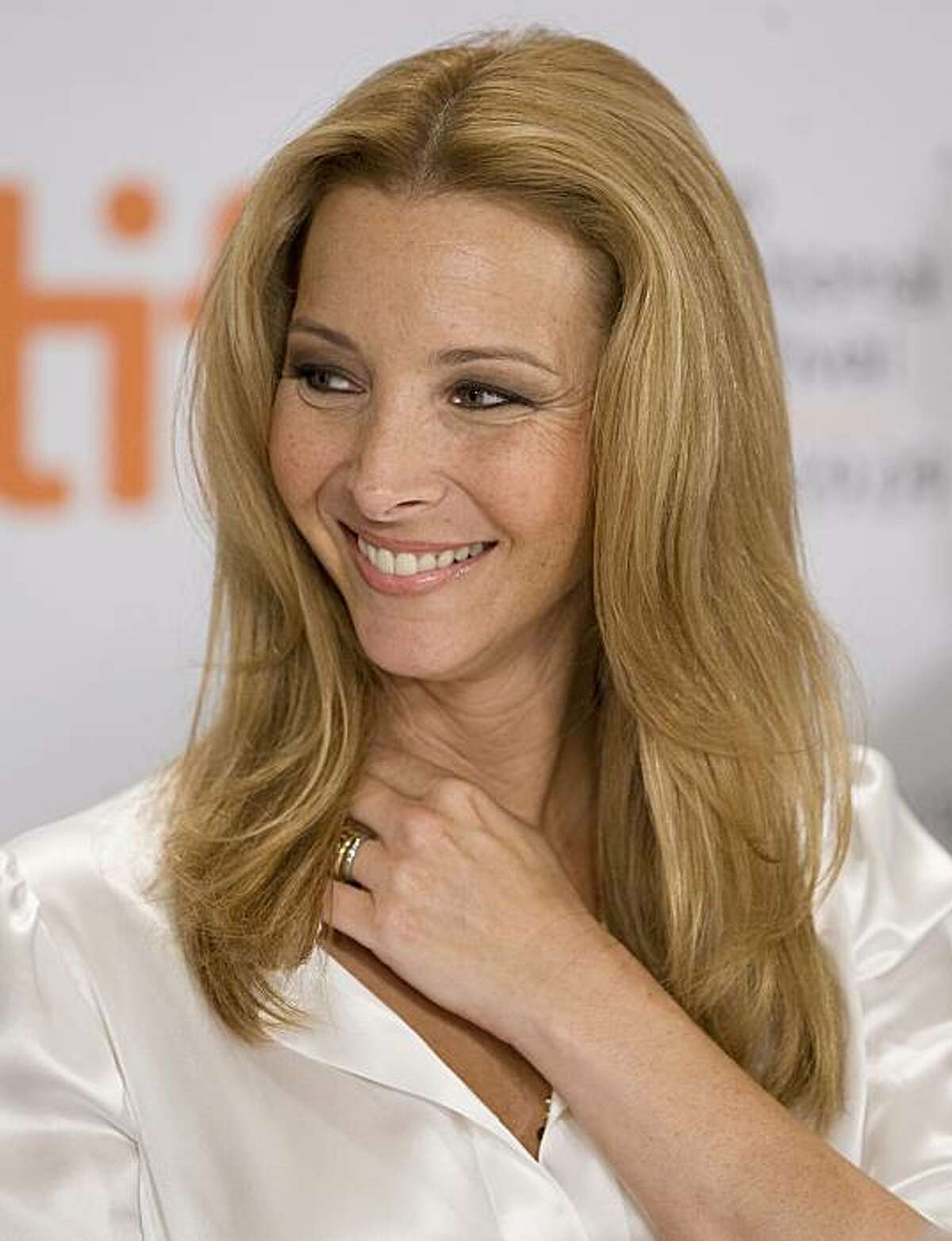 """Actress Lisa Kudrow takes part in a news conference for the film """"Love and Other Impossible Pursuits"""" during the Toronto International Film Festival in Toronto, Ontario, Wednesday, September 16, 2009."""