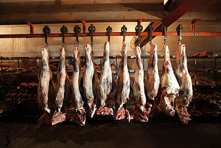 "Quarter cuts of beef hangs in the ""F Uri Meats"" packing plant in San Francisco, Calif. on Friday Jan. 21, 2011. 4th generation cattle rancher David Evans owner of  Marin Sun Farms, uses the facility to process the majority of his grass fed beef. Photo: Michael Macor, The Chronicle"