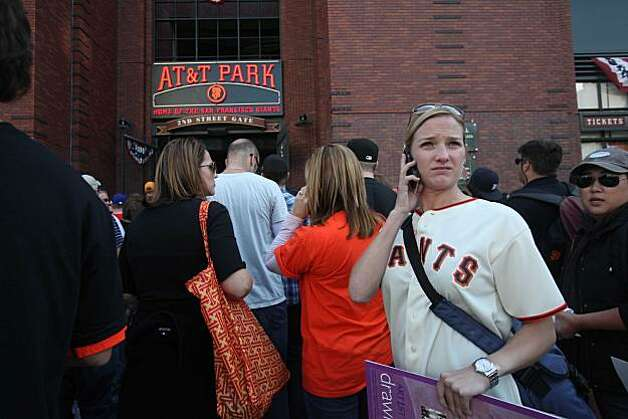Margot Grant, of San Francisco calls her friends outside AT&T Park before game 3 of the National League Champion series with the San Francisco Giants and the Philadelphia Phillies on Tuesday Nov. 19, 2010 in San Francisco, Calif. Photo: Mike Kepka, The Chronicle
