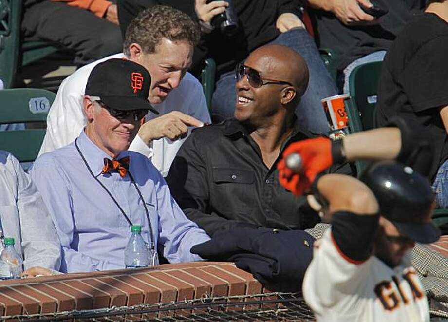 Bill Neukom, Larry Baer and Barry Bonds share a moment from their seats near home plate during game 3 of the National League Champion series with the San Francisco Giants and the Philadelphia Phillies on Tuesday Nov. 19, 2010 in San Francisco, Calif. Photo: Michael Macor, The Chronicle