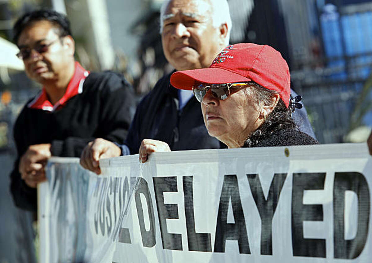 Guadalupe Vargas, 70, right, the widow of an ex-bracero, joins farm workers and their relatives gathered outside the Mexican Consulate in Los Angeles on Thursday, Feb. 3, 2011. Some 35,000 elderly Mexican farm workers who picked cotton, tomatoes and othercrops in the United States in 1942-1964 are urging the Mexican government to make good on a promise to pay them thousands of dollars.